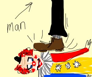 man stepping on a clown