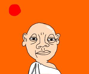 Bald man in white robe