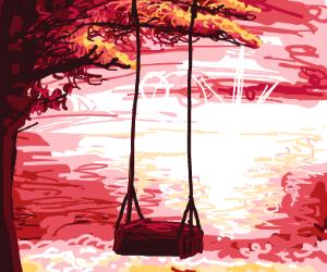 wooden swing w/ a beautiful sunset