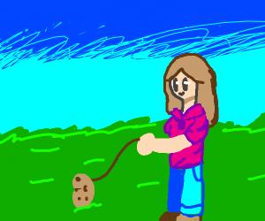 Little girl walking a potato.