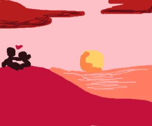Couple watching sunset at beach