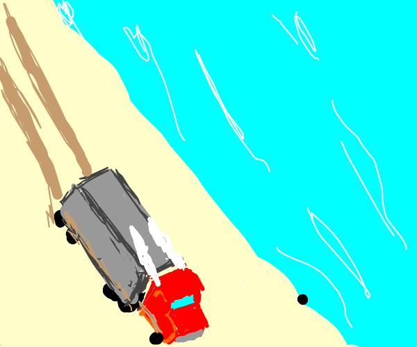 truck driving near a beach