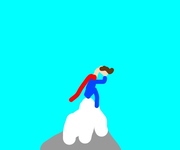 Superman contemplates life on a mountain