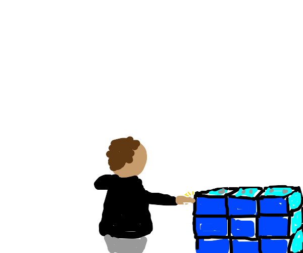 Person touches blue bricks