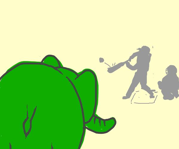 green elephant looks at baseball