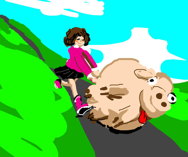 A girl pushes a pig down the road outside.