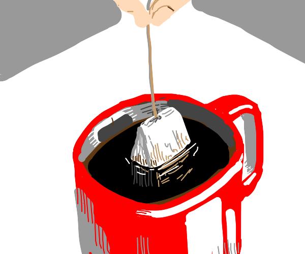 Tea bag in cup of coffee