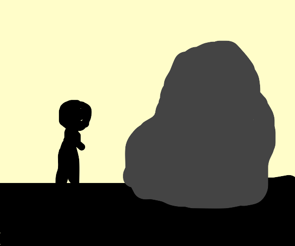 Man next to huge rock, only silhouettes