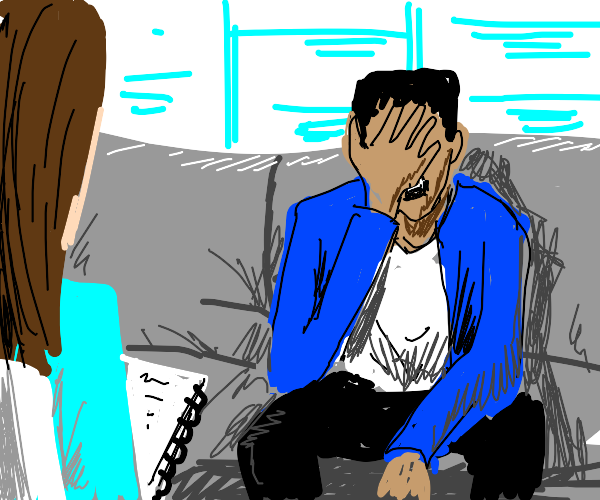 A person sitting in a therapy session.