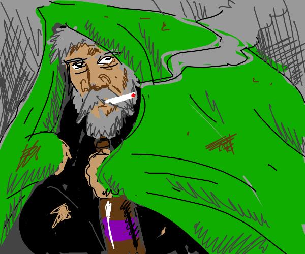 Hobo under green blanket