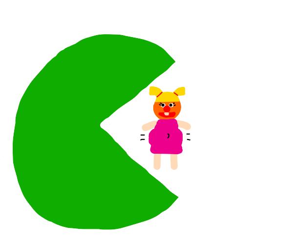 Green pac man eats pregnant muppet