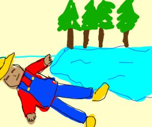 Farmer lays near water