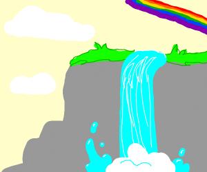 A rainbow over a waterfall