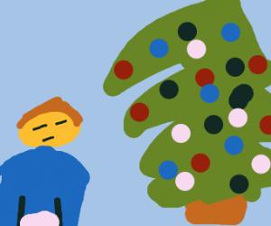 girl staring at christmas tree