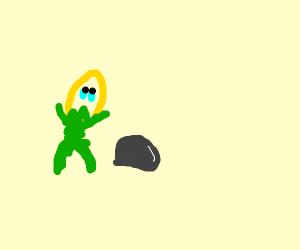 Sad pineapple man cry's at a rock
