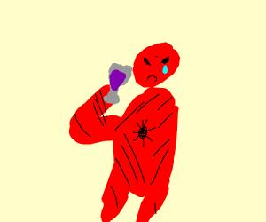 Spiderman drinks his sorrows away