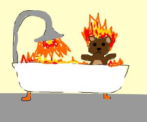 Teddy bear on fire in a bath