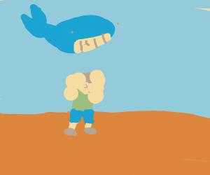 Muscular man stand under shark
