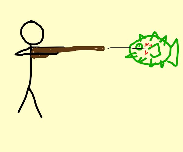 person shoots pufferfish