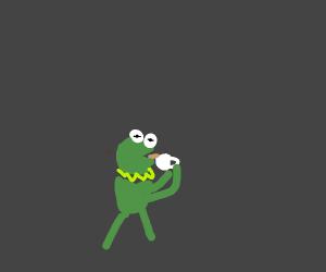Kermit the frog, sips tea