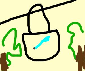 Pen in a bag with zipline