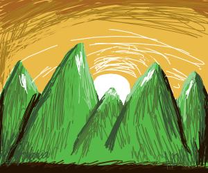 Sunset by mountain range