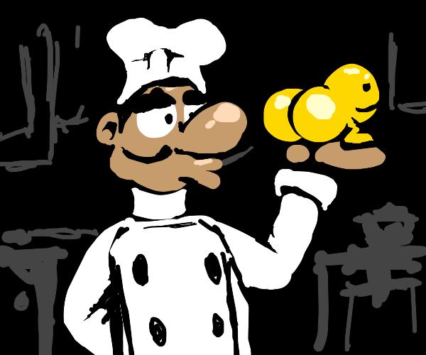 A chef holding one big ass egg yolk