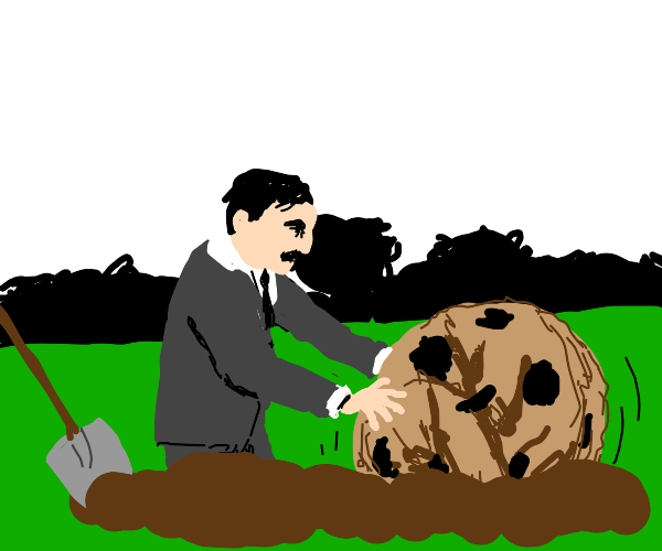 guy in suit digs up giant cookie