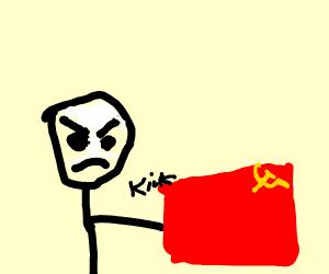 Man kicks the Russian flag