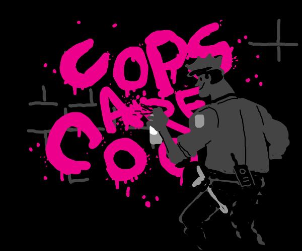 Policeman does graffiti.