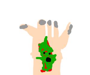 flesh like creature in a hand