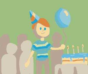 Birthday boy with blue balloon