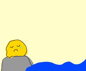 sad yellow blob on a rock