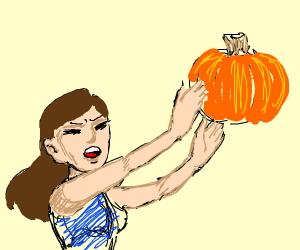 woman throwing pumpkin