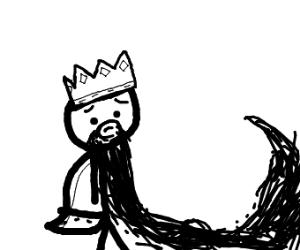 Sad old King with long beard wearing crown