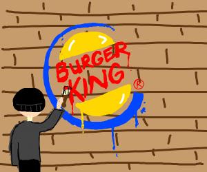 Guy painting burger king logo