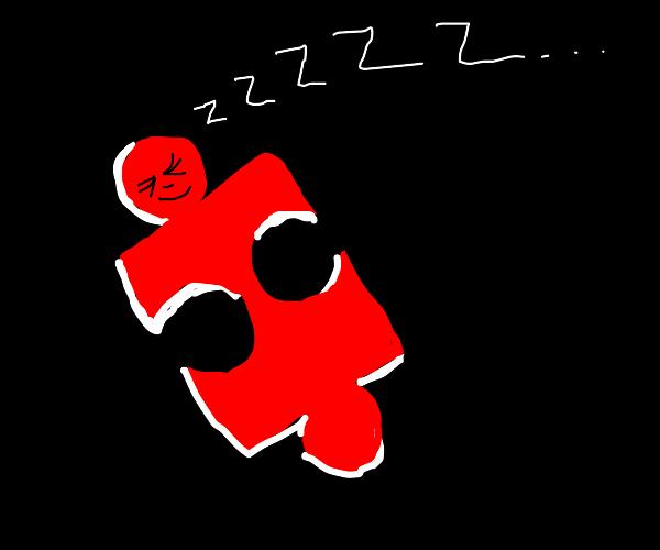 Sleeping red jigsaw puzzle piece
