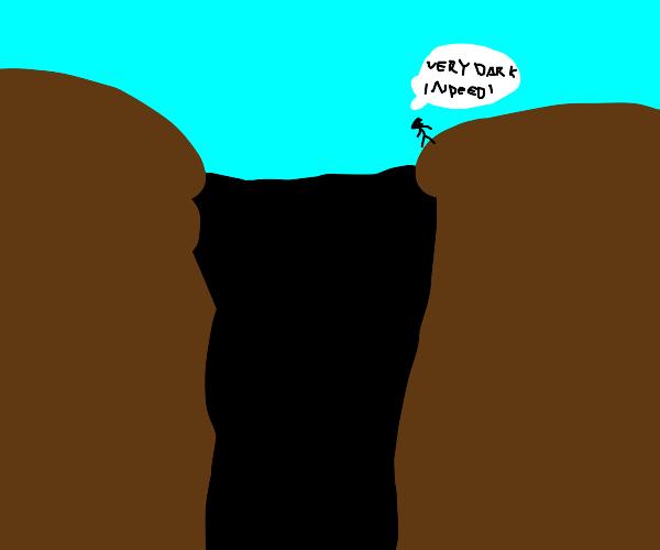 Man at the edge of the Dark Canyon