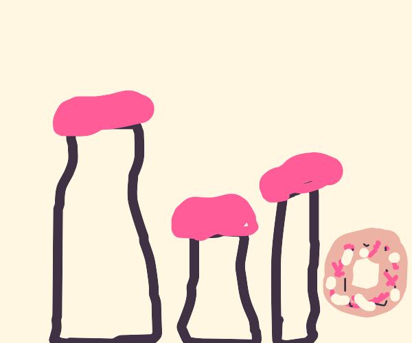 three milk jars and donuts