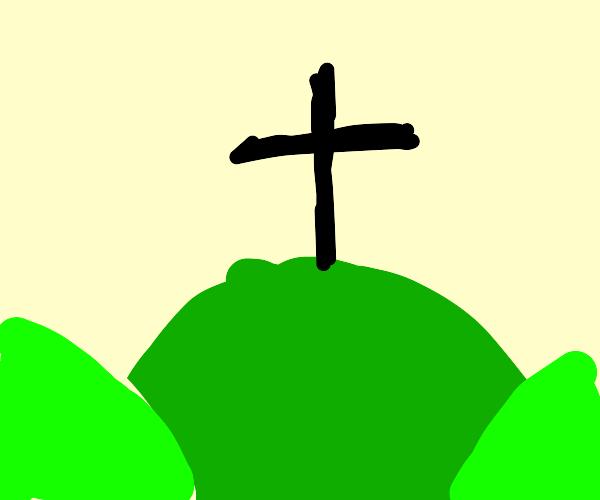 a crucifix on a hill