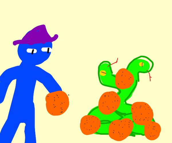 "Naked BlueMan hiding his ""snake"" with oranges"