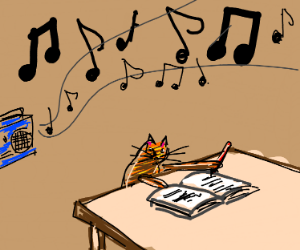 Cat listens to music while doing his homework