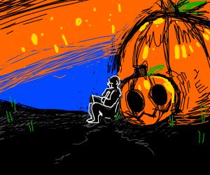 Hopeless artist rests by big pumpkin