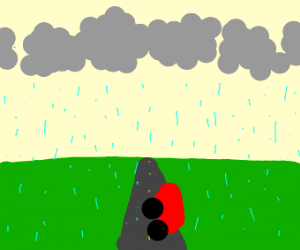 Red car on road in rain