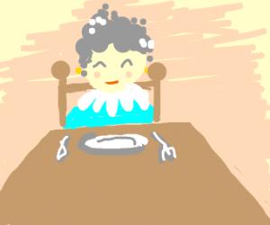 Grandma sits at a table