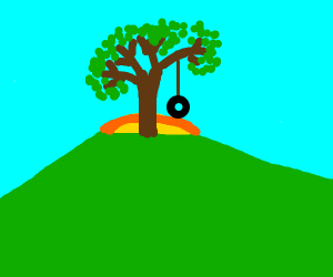 lone tree with tyre swing on a hill at sunset