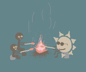 Dad, son and sun enjoy the campfire.