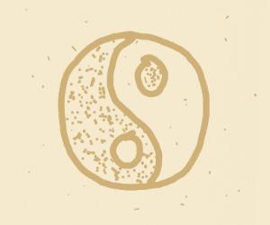 Ying-Yang symbol in sand