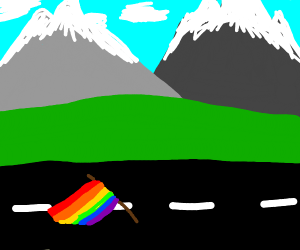 Pride flag laying flat on a road