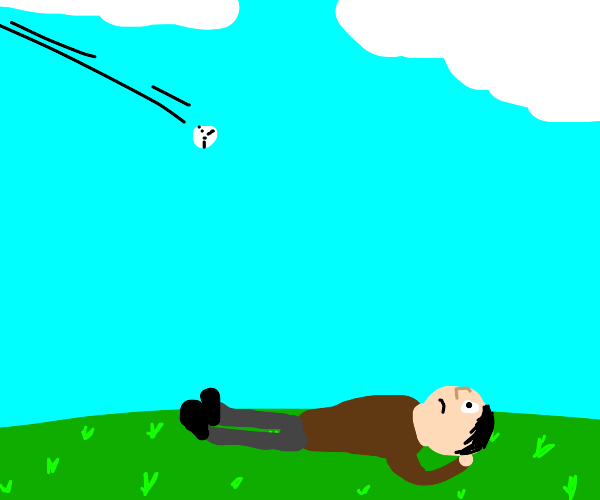 Ball flies towards man laying on the ground